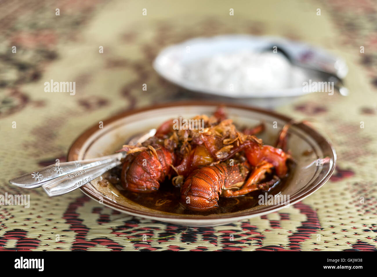 Red lobster in indoinesian beach style cuisine - Stock Image