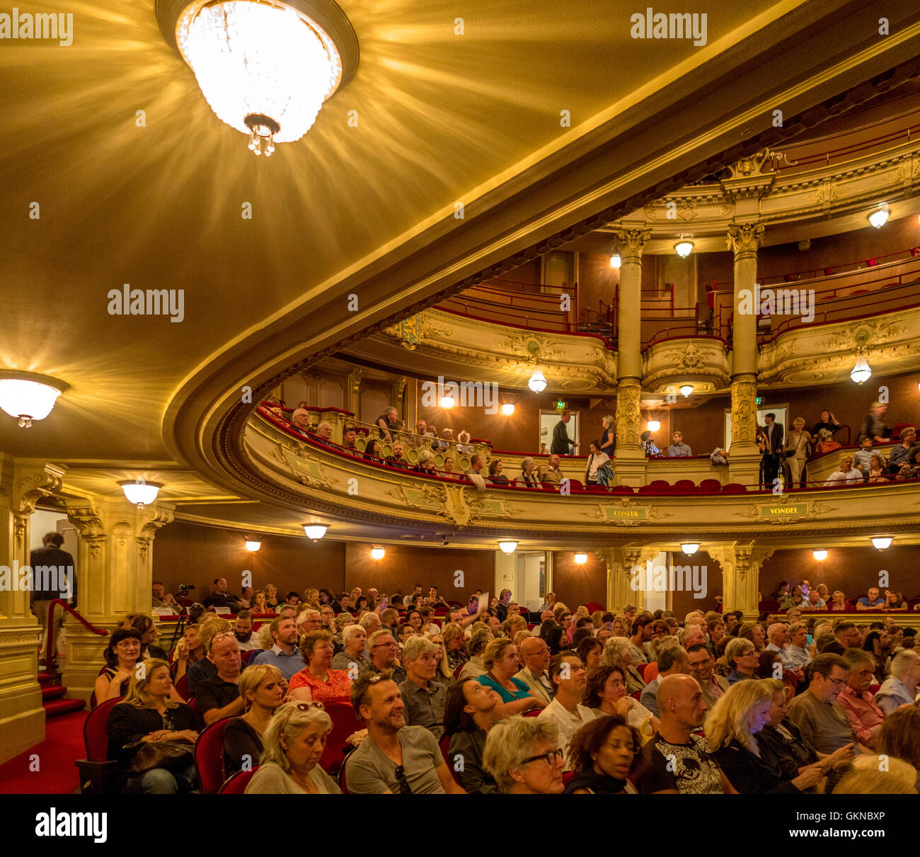 https://c7.alamy.com/comp/GKNBXP/amsterdam-municipal-theater-dutch-stadsschouwburg-interior-with-people-GKNBXP.jpg