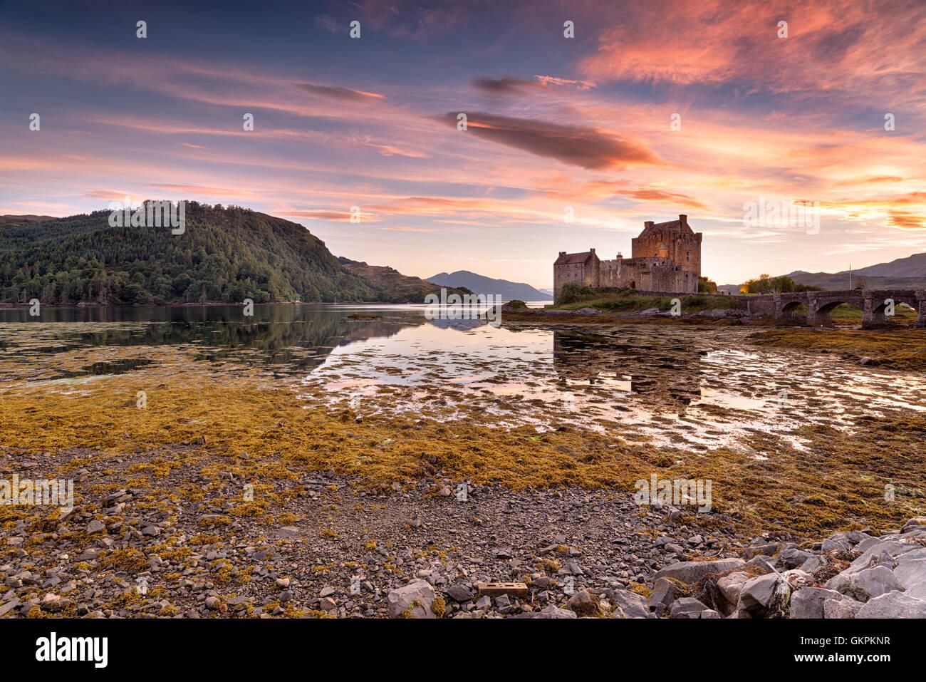 Stunning evening sky over Eilean Donan castle on the western coast of the Scottsih highlands - Stock Image