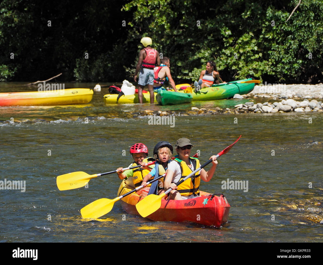 Mother with young children going on a canoeing adventure on the Herault river in the Cevennes region, southern France - Stock Image