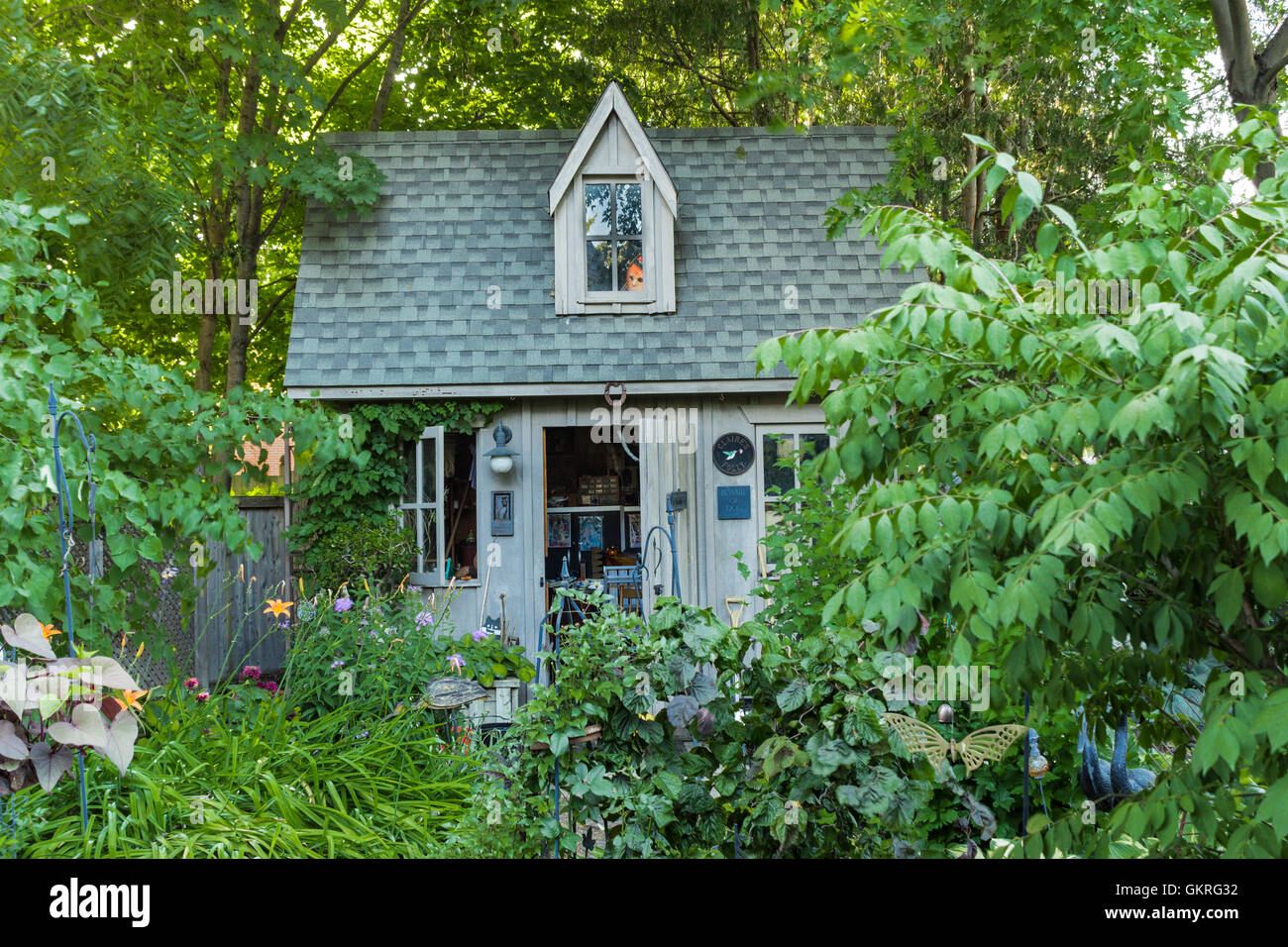 large-garden-shed-with-dolls-face-in-the-window-GKRG32.jpg