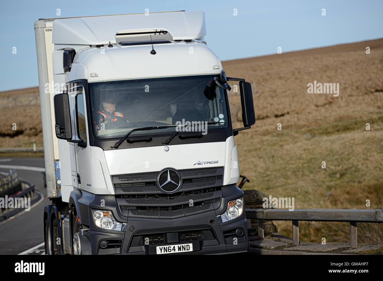 A Mercedes Benz Actros Cutainsider Truck Takes A Bend Over A Bridge On The  A628 Woodhead Pass