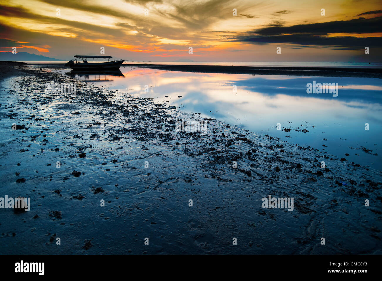 Colorful sunset with old fisherman boat, Java, Indonesia - Stock Image