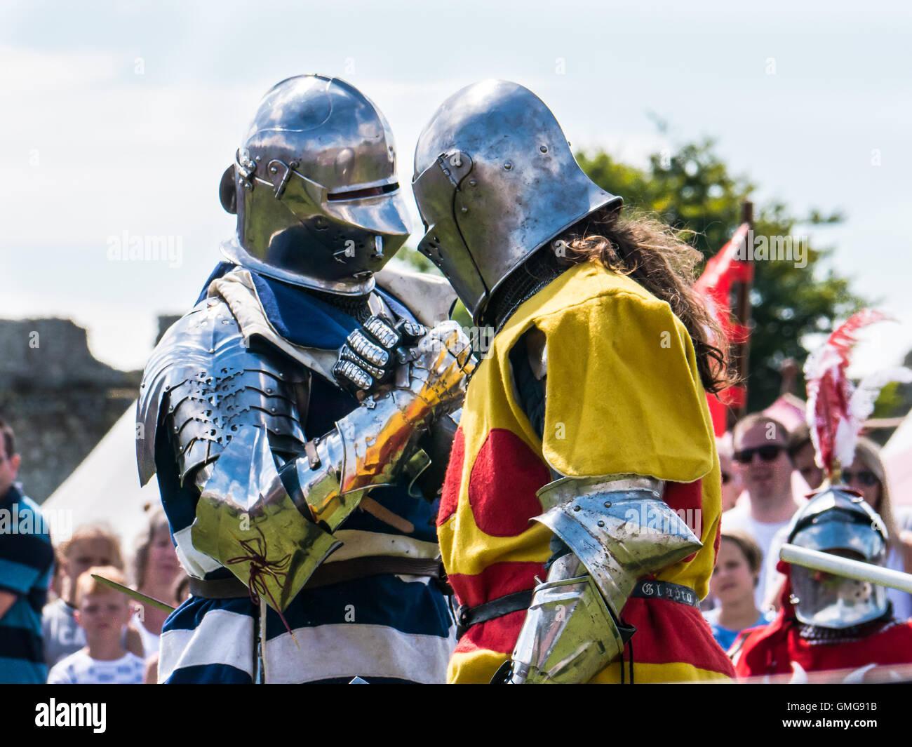 two-medieval-combat-reenactors-in-full-armour-shake-hands-prior-to-GMG91B.jpg