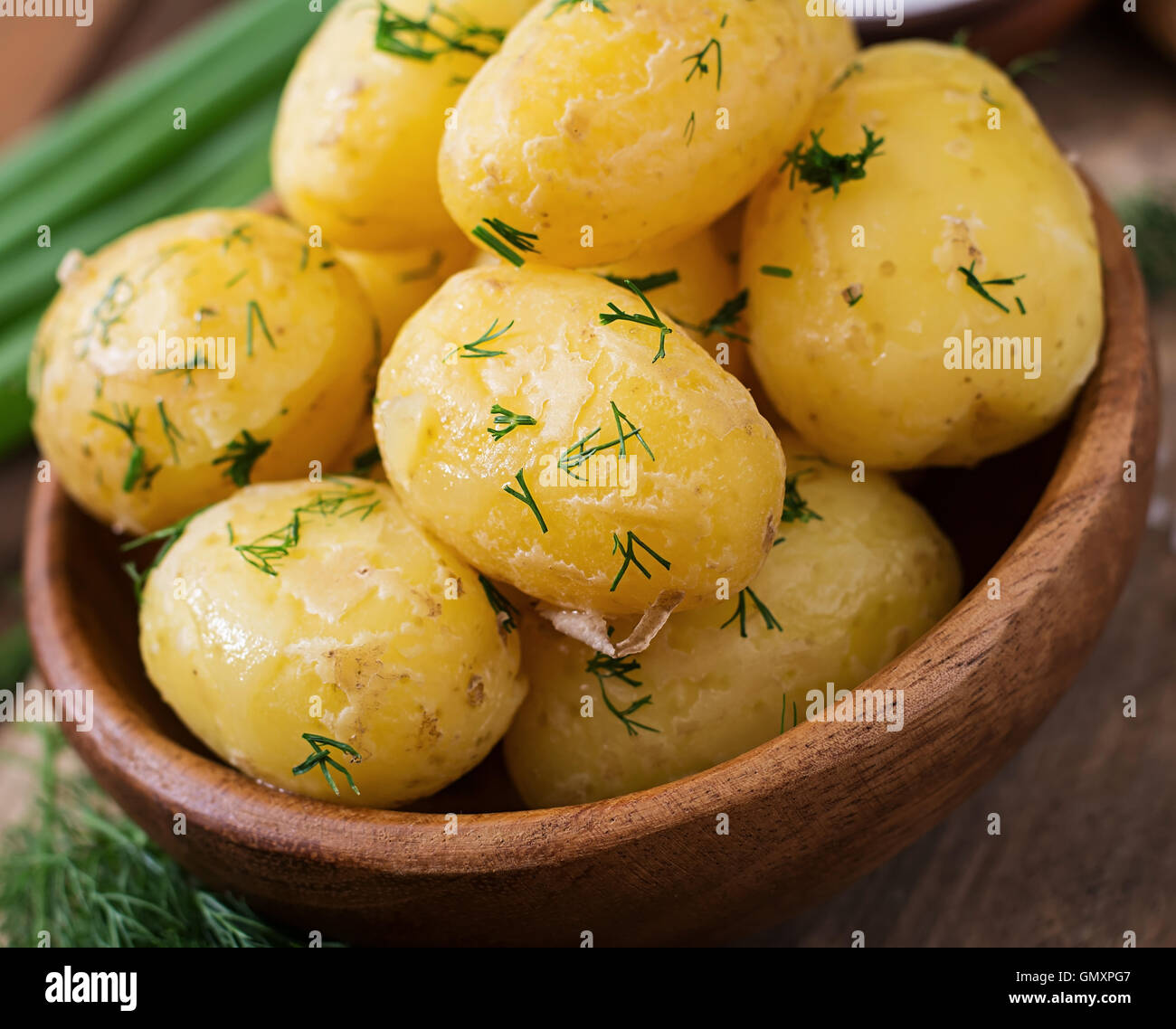 Boiled new potatoes seasoned with dill and butter - Stock Image