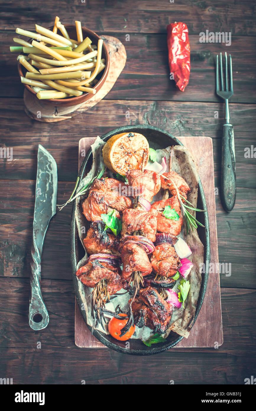 Grilled pork skewers rustic - Stock Image