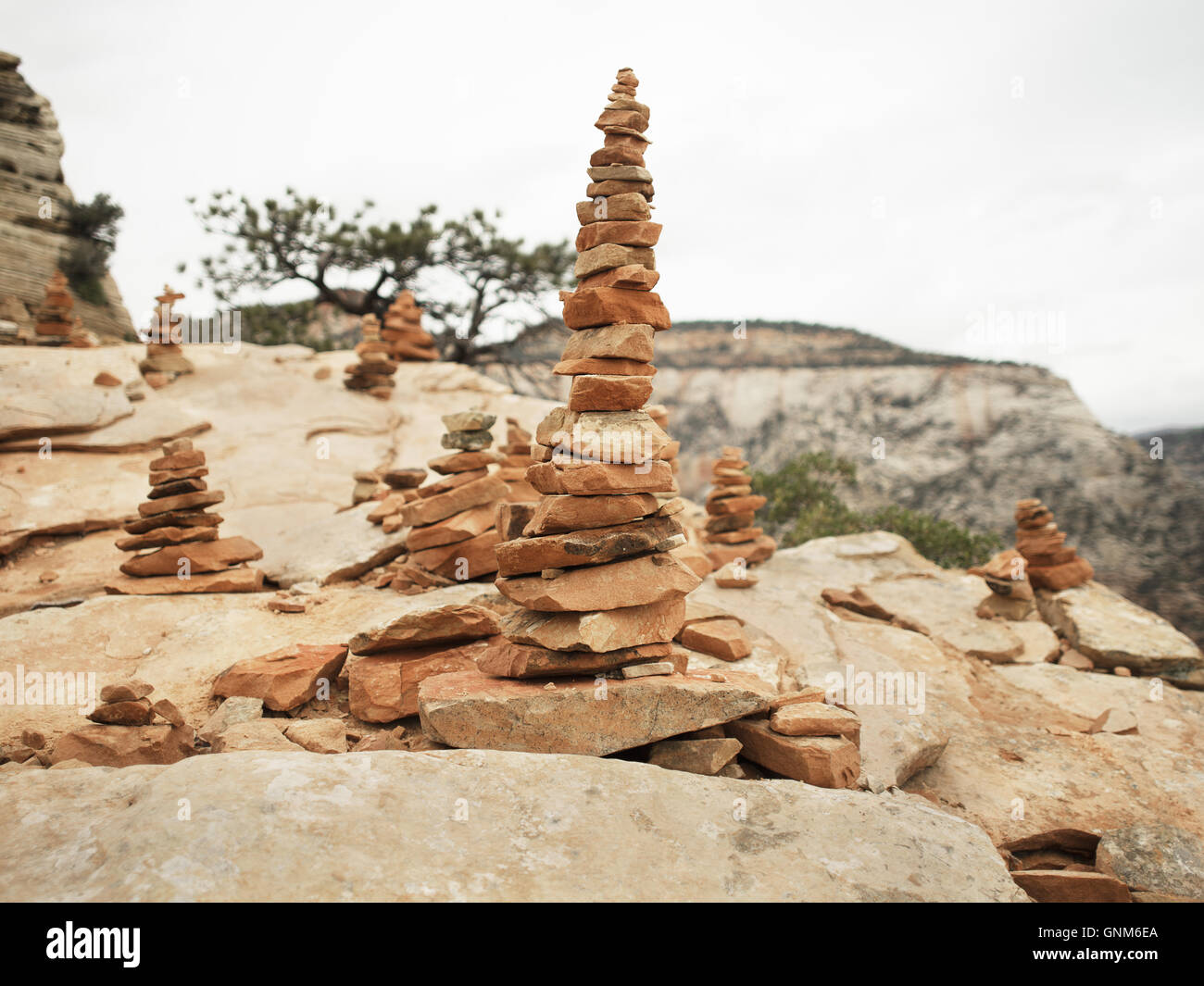 Stacks of rocks mark the trail for paths in Zion National Park and other hikes in southern Utah - Stock Image