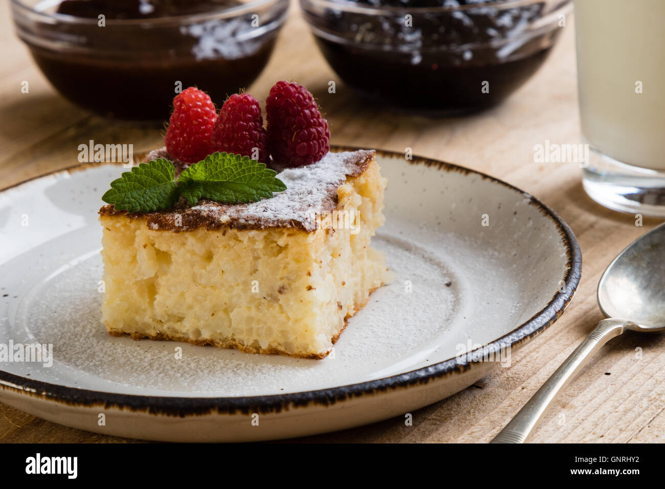 traditional homemade baked rice pudding with rasberry - Stock Image