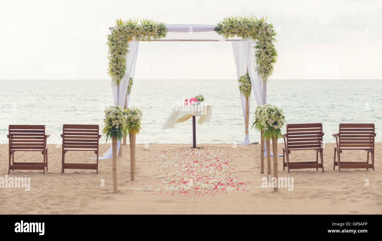 Simple style wedding arch and decoration venue setup on tropical simple style wedding arch and decoration venue setup on tropical beach outdoor beach wedding vintage process junglespirit Image collections