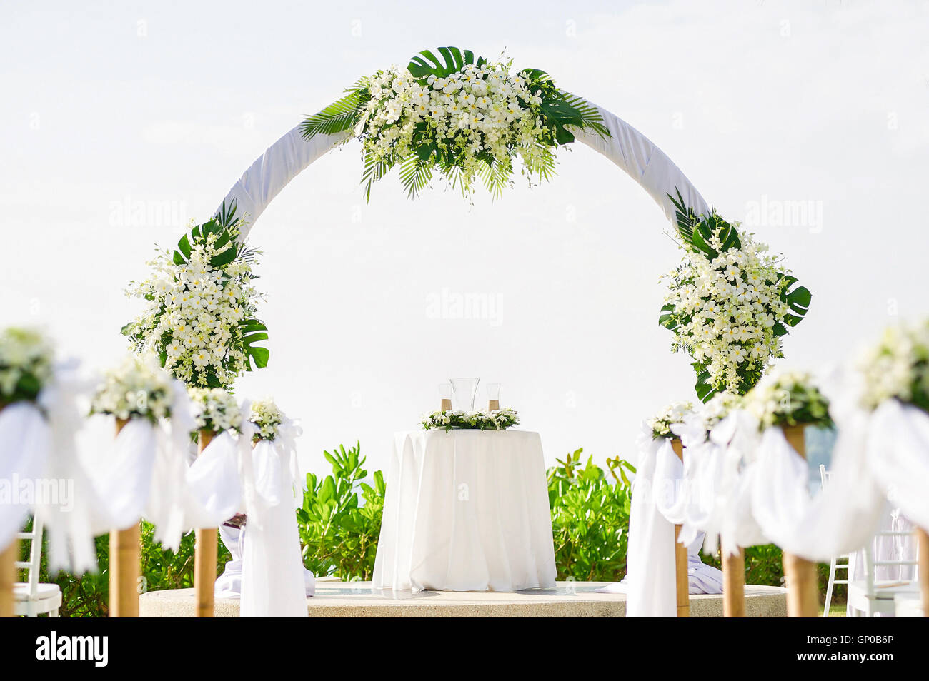 Simple style wedding arch and decoration venue setup on tropical simple style wedding arch and decoration venue setup on tropical beach outdoor beach wedding junglespirit Image collections