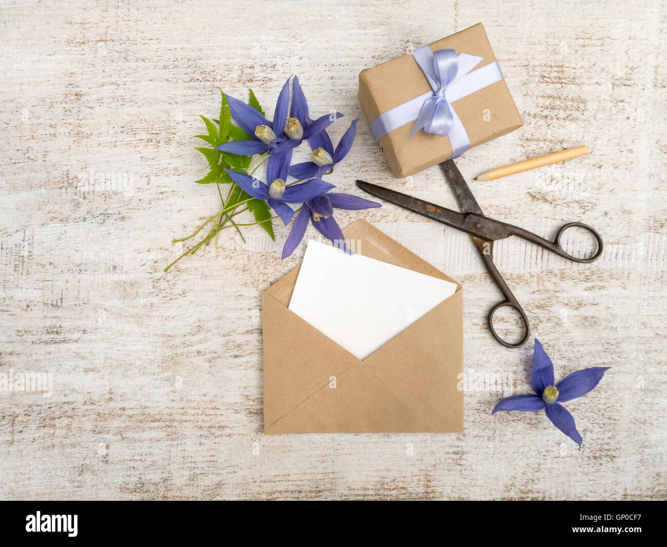 Gift Box Blue Flowers And Envelope With Greeting Card On The Wooden Painted Board