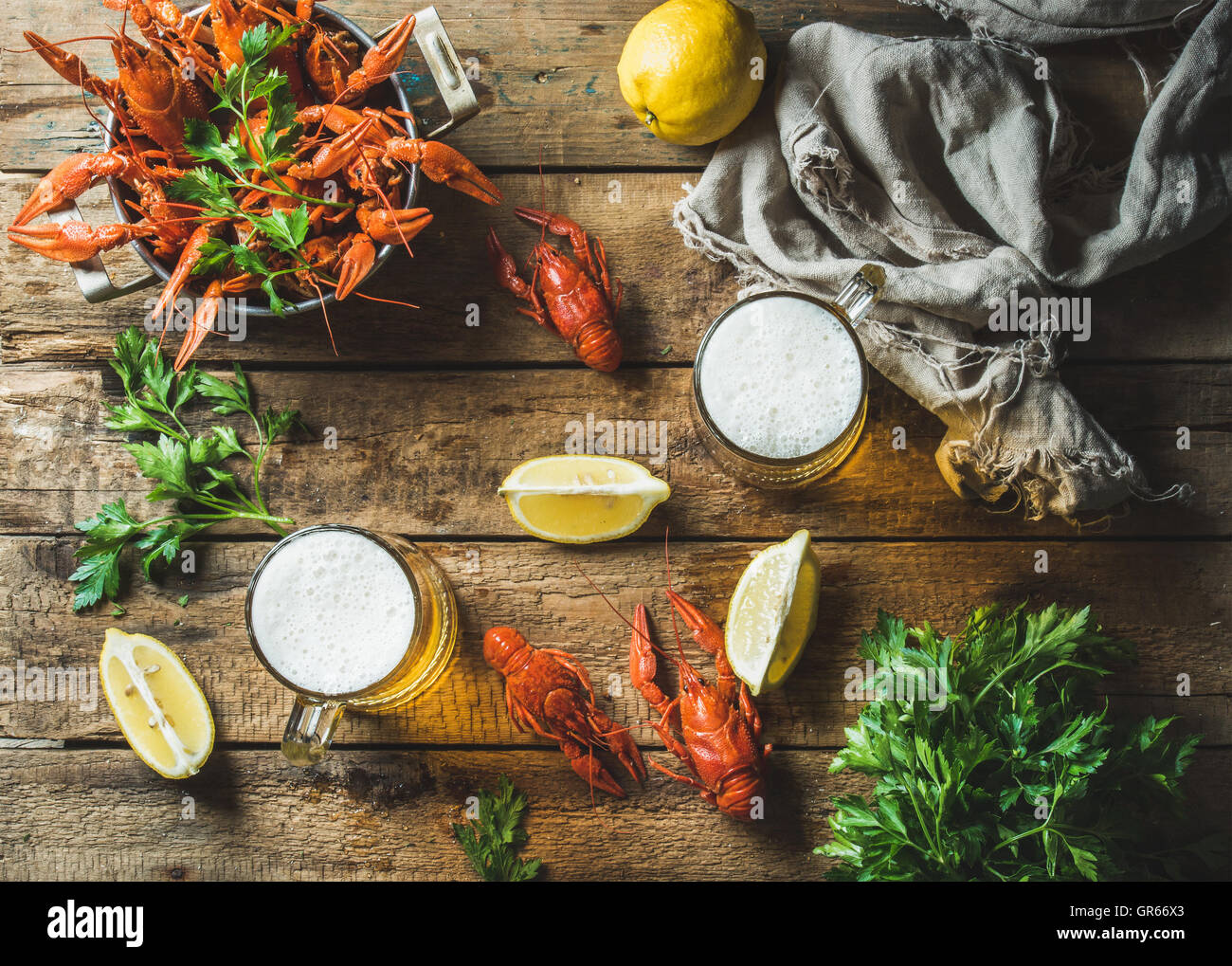 Wheat beer and boiled crayfish with lemon, parsley - Stock Image
