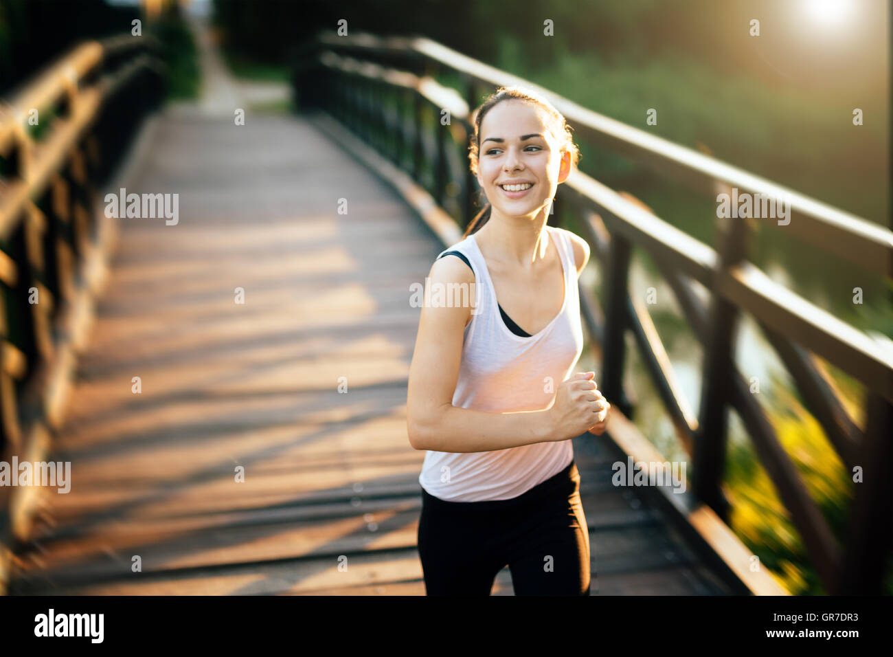 Sporty woman living a healthy life - Stock Image