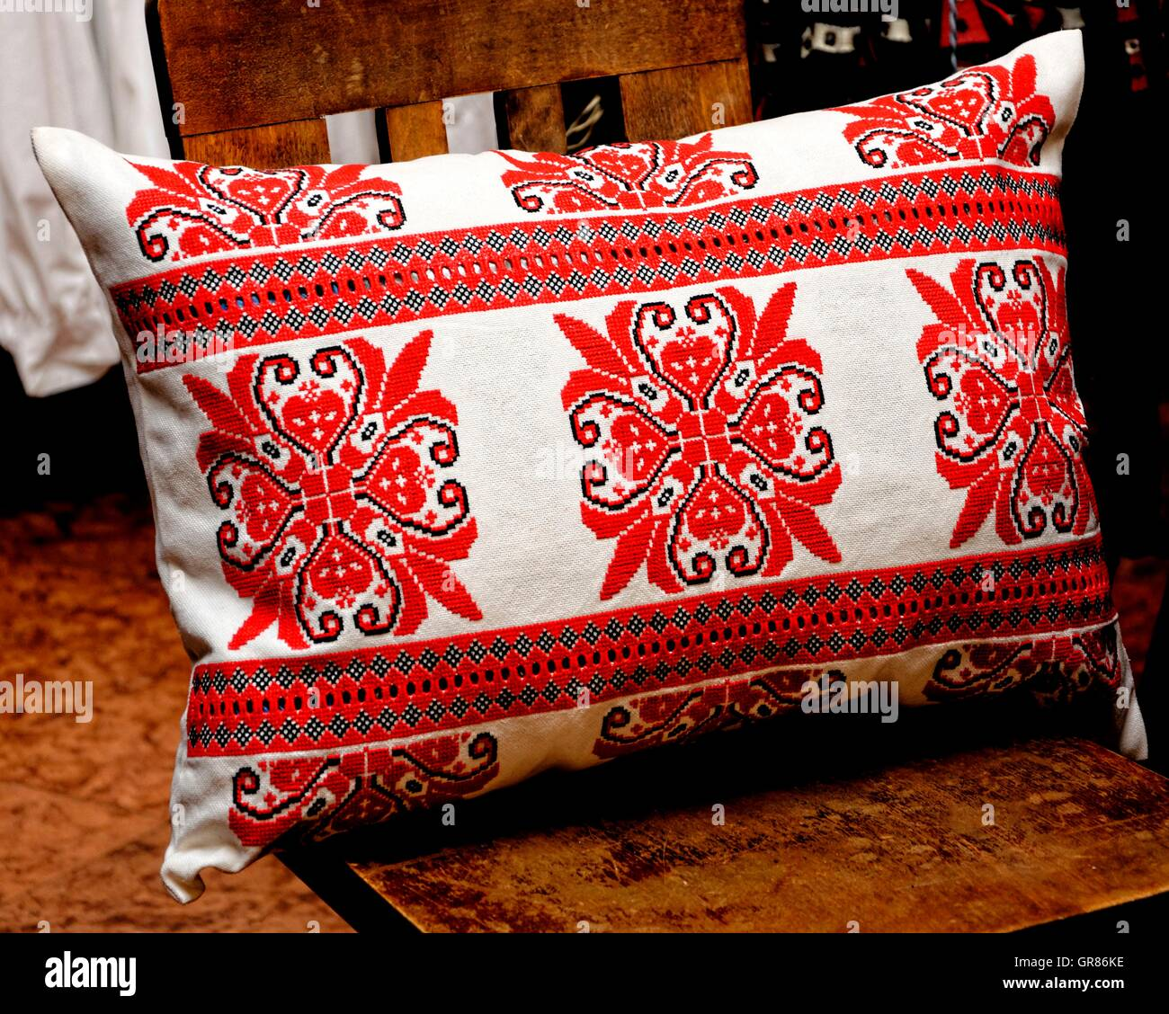 Pillow In Red Cross-Stitch Embroidery - Stock Image