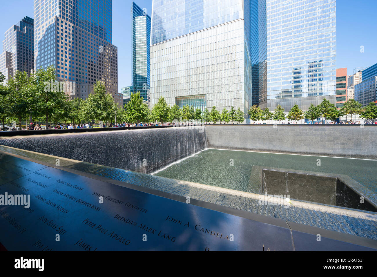 NEW YORK CITY - SEPTEMBER 4, 2016: Names of victims surround the North Pool of the National September 11 Memorial. - Stock Image