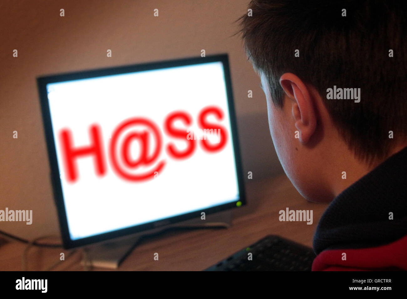 Word Hate With At Sign And Computer Screen - Stock Image