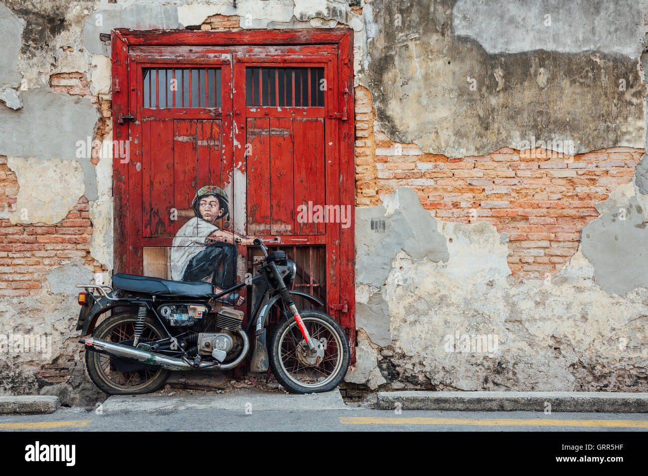 George Town, Malaysia - March 21, 2016: Famous creative Penang street art on the wall of UNESCO Heritage Buffer Stock Photo