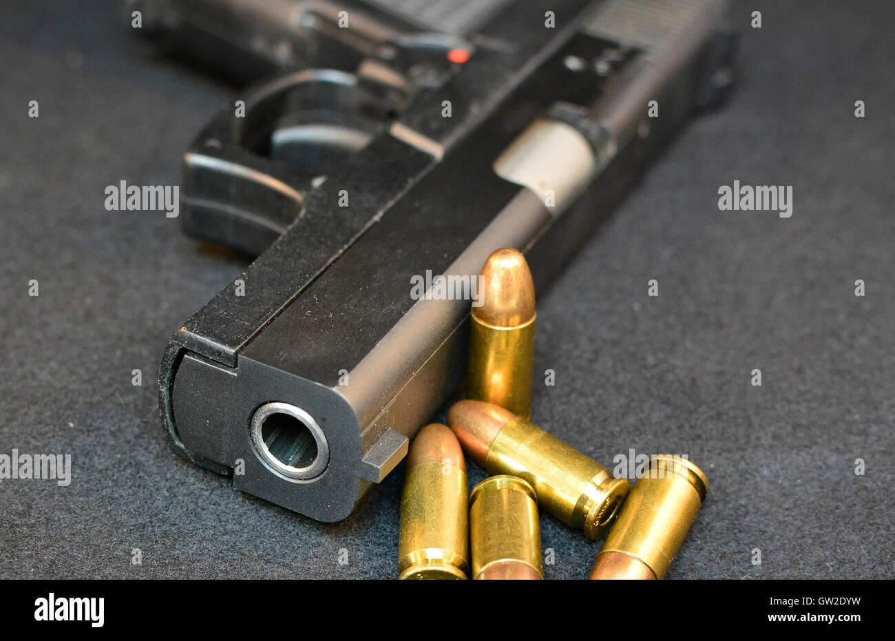 Handgun with bullets. Gun violent crime, assault. Shooting. Gun use. - Stock Image