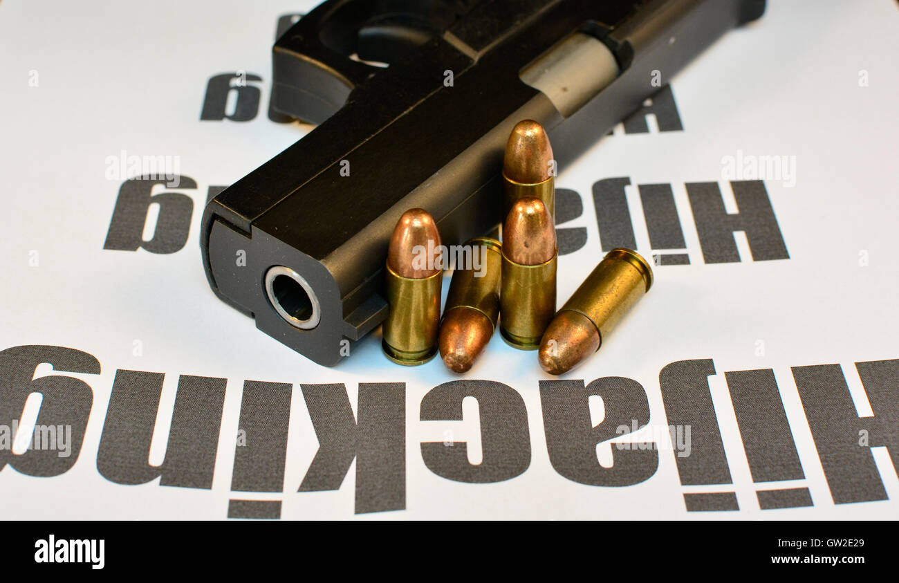 Crime Hijacking and vehicle theft concept. Handgun with bullets gun violent crime, assault. Shooting. - Stock Image