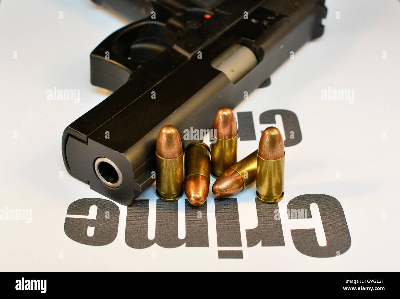 Crime Concept. Handgun with bullets gun violent crime, assault. Shooting. - Stock Image