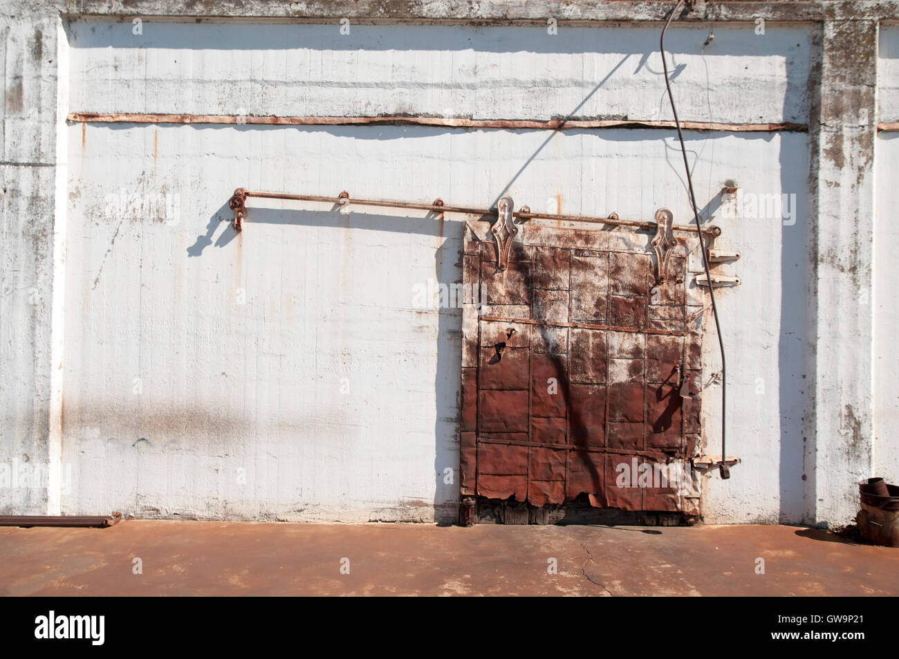Warehouse Style Sliding Door On A Partially Ruined Building Stock