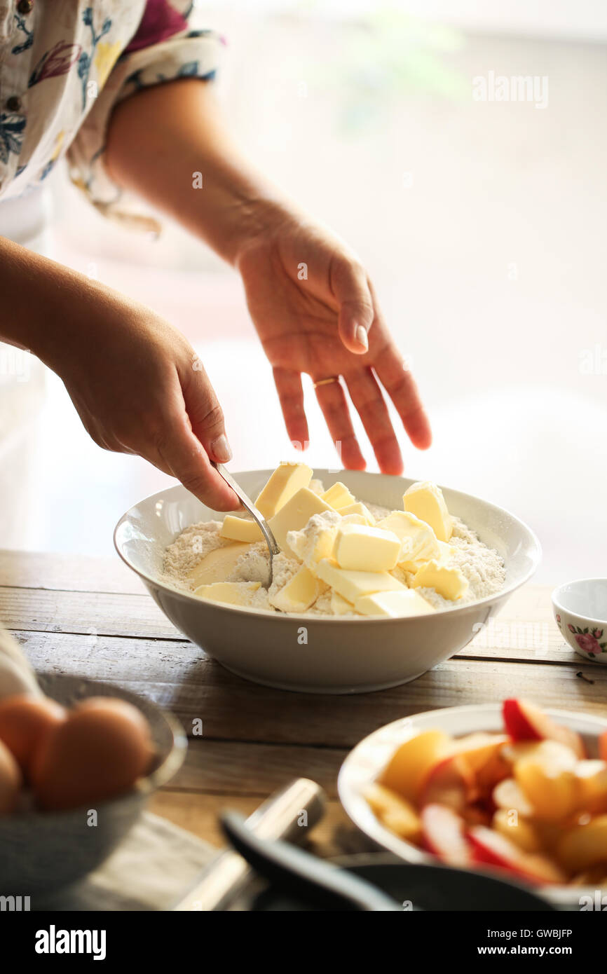 Woman miking butter and flour - Stock Image