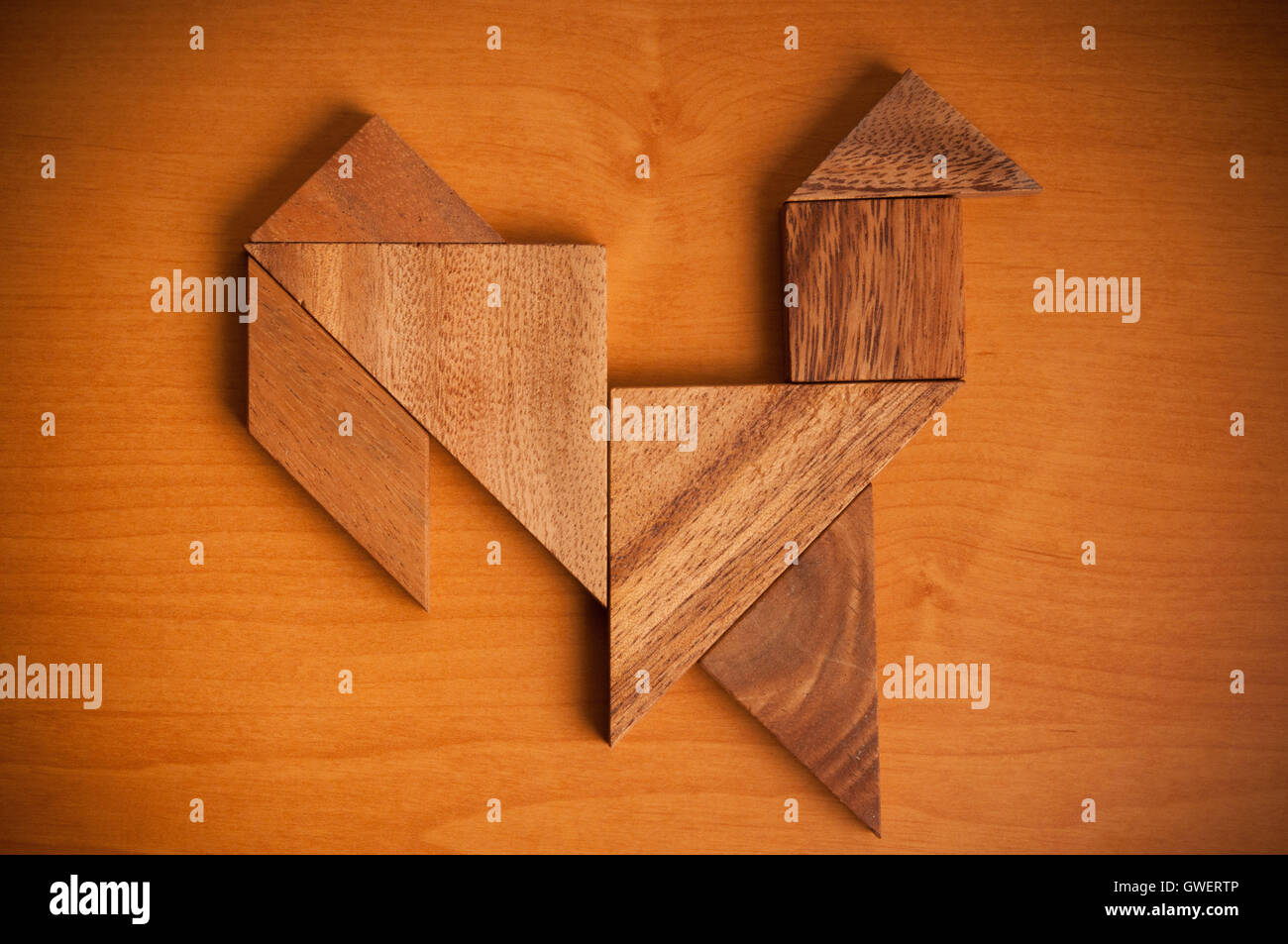 Tangram figure rooster - Stock Image