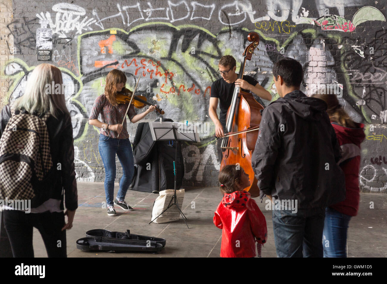 a-pair-of-musicians-busking-on-clink-str