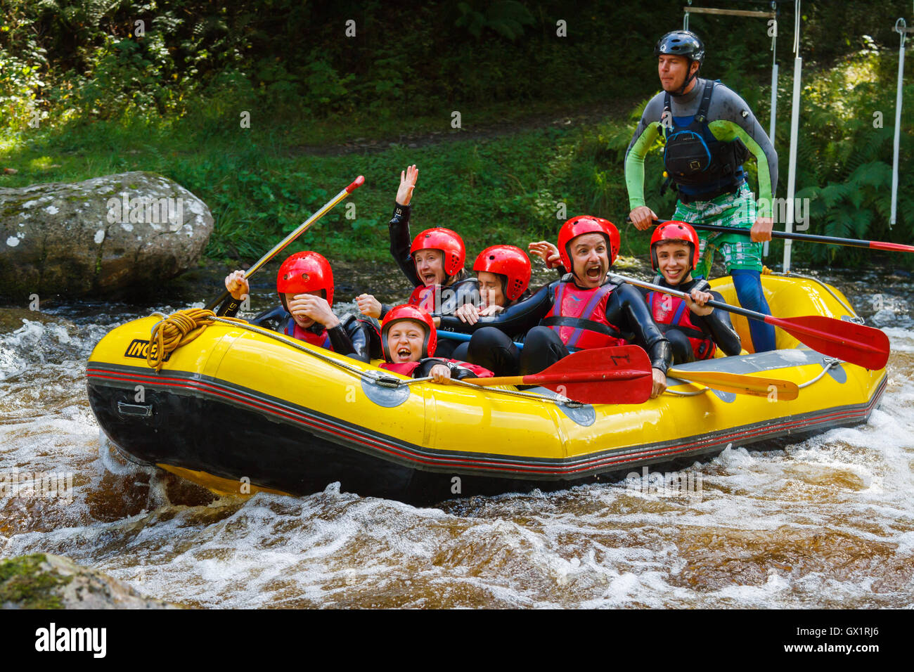 White water rafters having had a good soaking at the National White Water Centre on the River Tryweryn outside Bala Stock Photo