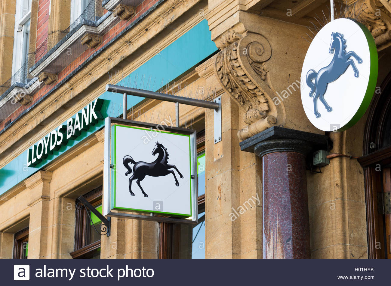 Close-up of the spelt and logo signs above a branch of Lloyds Bank in Honiton, North Devon, England Stock Photo