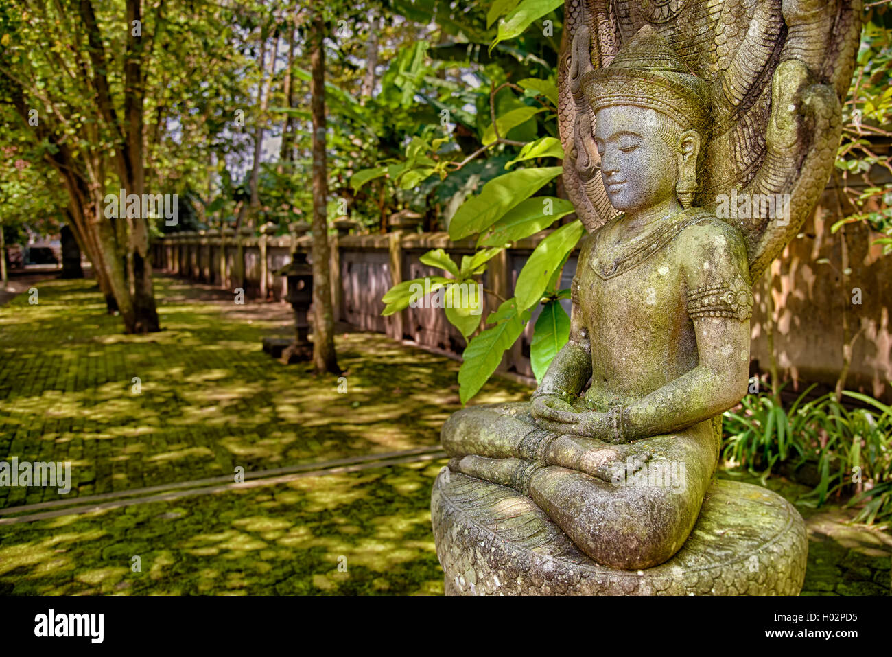 Stone image of meditating Buddha in Mendut temple, Indoensia - Stock Image