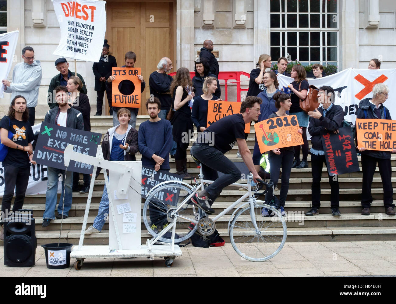 Climate change protesters demonstrate against fossil fuel investment outside Hackney Town Hall, London - Stock Image