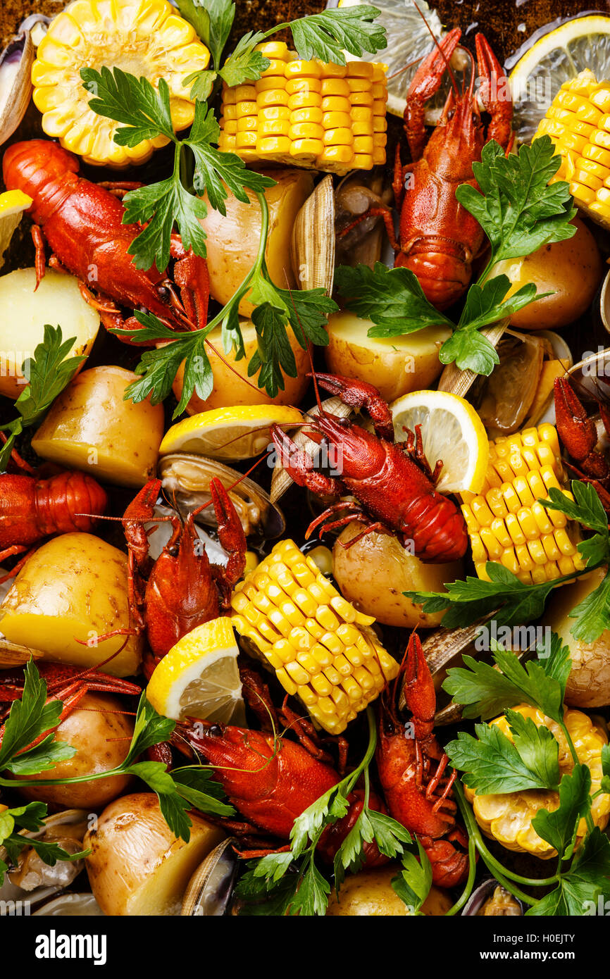 Clambake Seafood boil with boiled Crayfish, Corn on the Cob, Potatoes and Clams - Stock Image