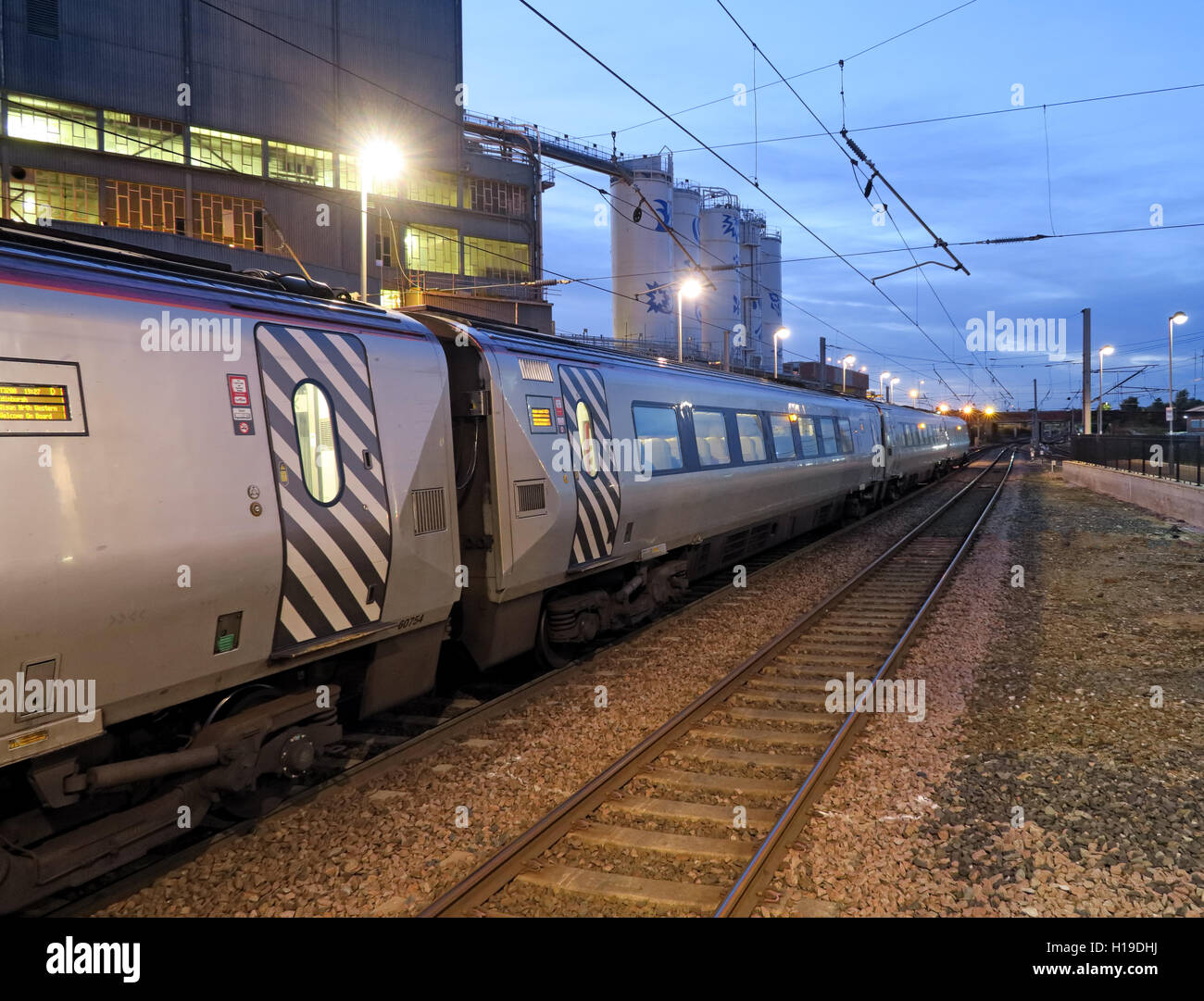 West,coast,main,line,mainline,BR,privitised,rail,rails,track,tracks,Northbound,dusk,at,night,evening,franchise,lighting,Lever,plant,factory,WBQ,profit,profits,expensive,increase,overhead,cable,cables,problem,delay,delays,Virgin Pendolino,electric train,Warrington Bank Quay,railway station,GoTonySmith,@HotpixUK,Tony,Smith,UK,GB,Great,Britain,United,Kingdom,English,British,England,delay,delays,delayed.late,later,Buy Pictures of,Buy Images Of,Images of,Stock Images,Tony Smith,United Kingdom,Great Britain,British Isles