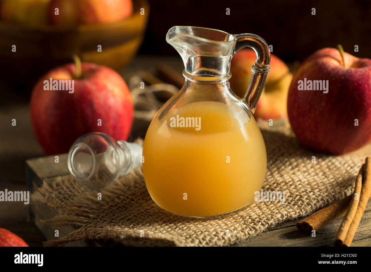 Raw Organic Apple Cider Vinegar in a Bottle - Stock Image