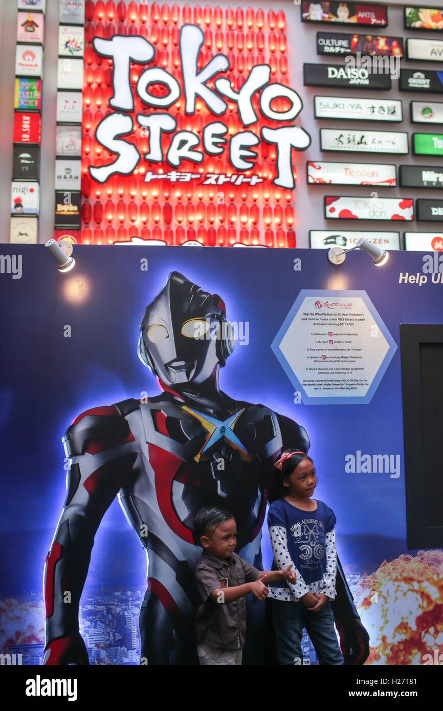 Children Posing In Front The Poster Of Ultraman Meet And Greet Stock