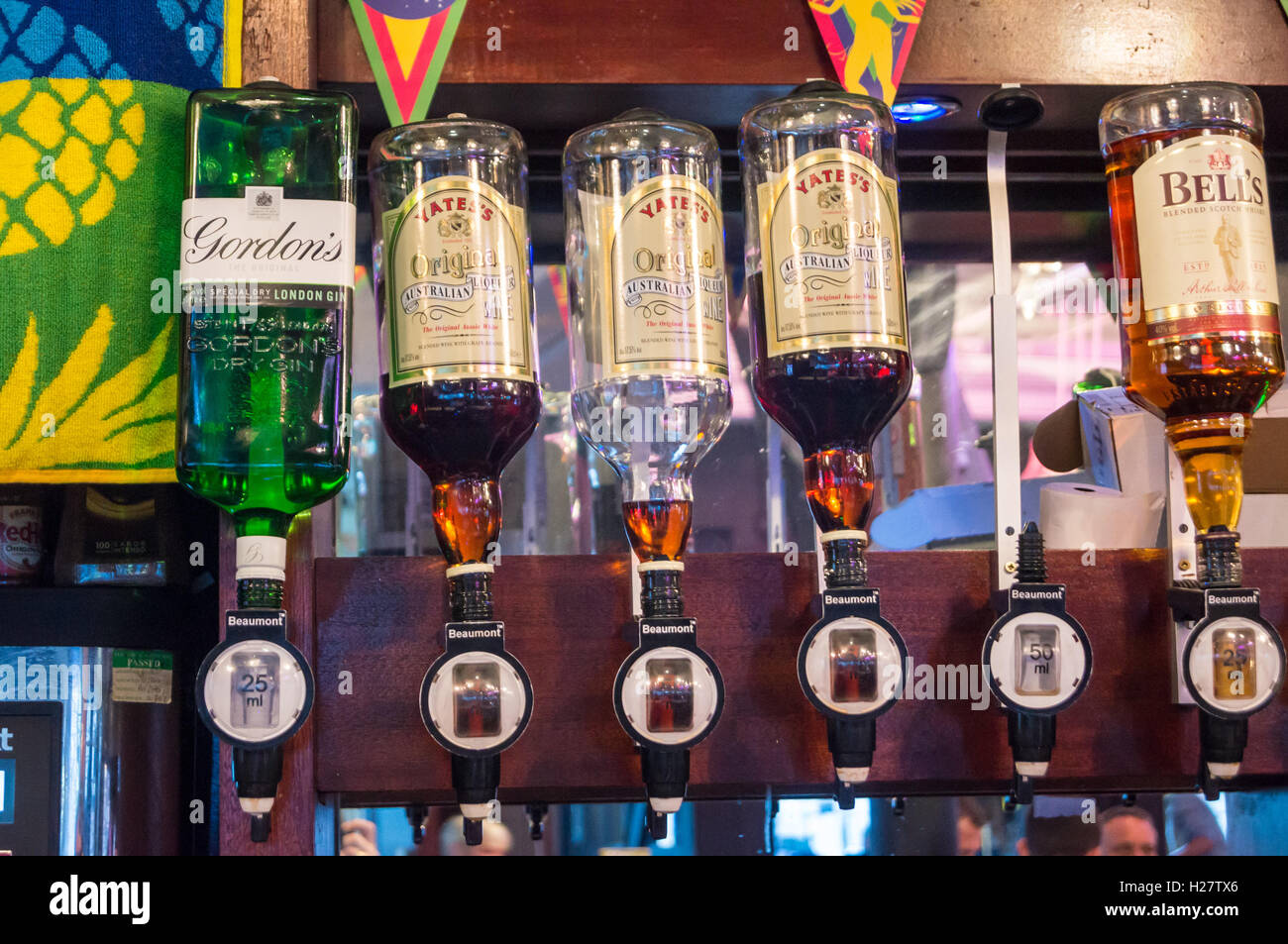 Optic drink dispensers containing Australian liqueur wine, gin and Scotch, Yates's Wine Lodge Portland Street Manchester Stock Photo