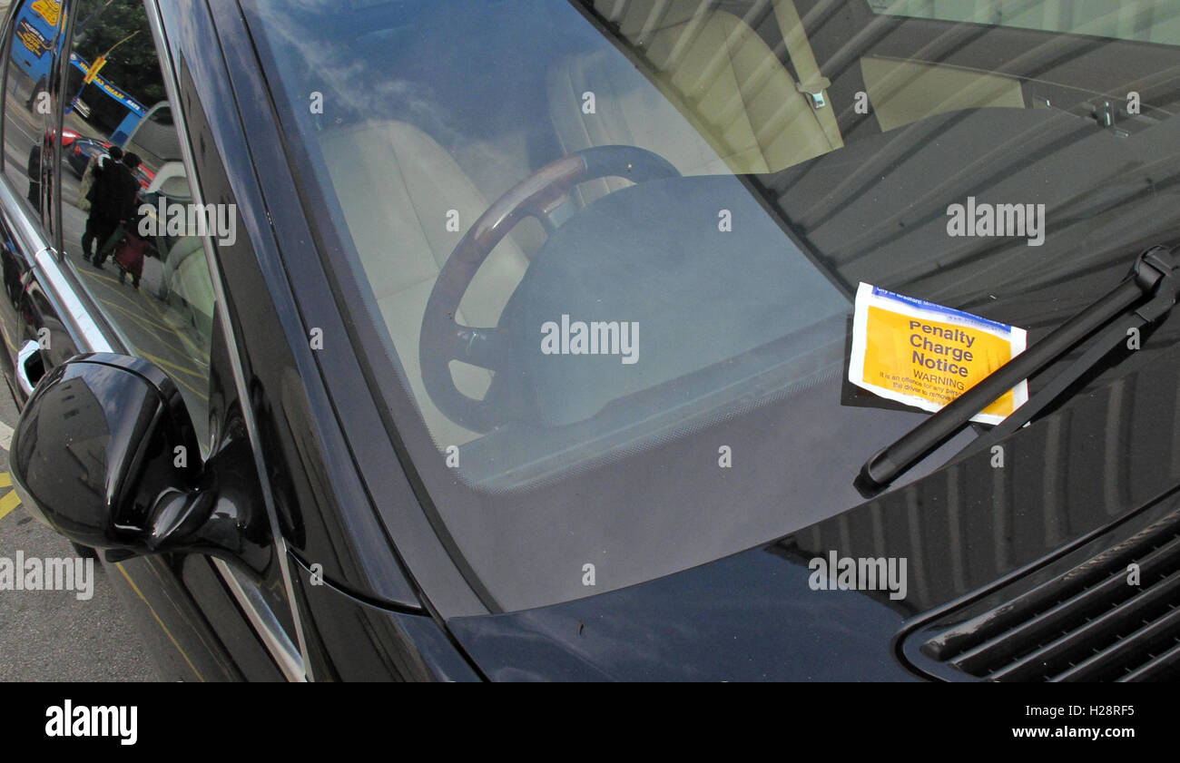 fine,charge,offence,driving,park,parking ticket,vehicle,auto,automobile,yellow,under,wiper,blade,wiperblade,window,ticket,unfair,fair,duration,illegal,clamp,clampers,fine,fines,PCN,pay,Black car,Penalty Charge Notice,under wiper,Penalty Charge,Charge Notice,Parking fines,GoTonySmith,@HotpixUK,Tony,Smith,UK,GB,Great,Britain,United,Kingdom,English,British,England,restriction,restrictions,council,services,local,authority,Buy Pictures of,Buy Images Of,Images of,Stock Images,Tony Smith,United Kingdom,Great Britain,British Isles,parking restrictions,parking information,Parking services