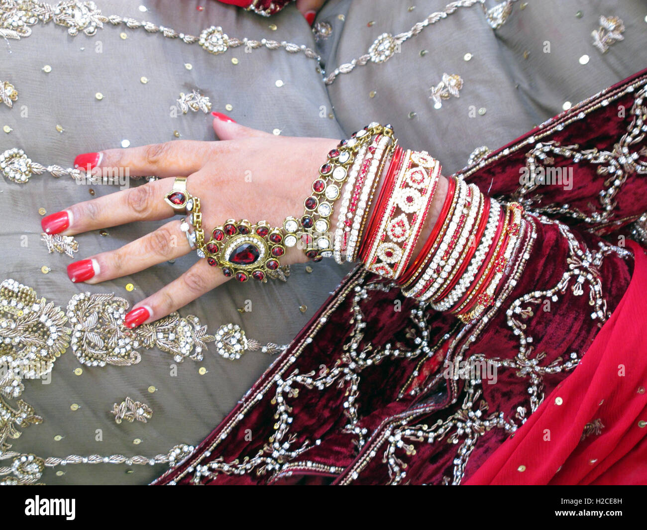 Muslim,Islam,adult,age,aged,arms,asia,asian,bracelets,bride,finger,carat,ceremony,chest,classy,concept,costume,cover,covering,crossed,crossing,dress,expensive,female,females,girl,gold,hands,henna,india,indian,jewelery,ladies,lady,luxurious,mangalsutra,marriage,married,mature,middle,necklace,oriental,GoTonySmith,@HotpixUK,Tony,Smith,different,unique,pakistan,pakistani,placing,posh,rings,sari,wedding,woman,women,Buy Pictures of,Buy Images Of,Images of,Stock Images,Tony Smith,Photo of