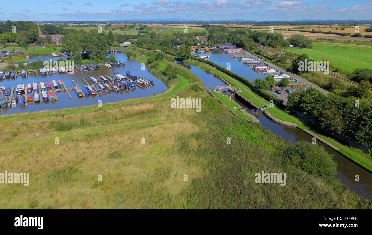 Aerial view of Rufford canal basin, narrow boats, lock and railway - Stock Image