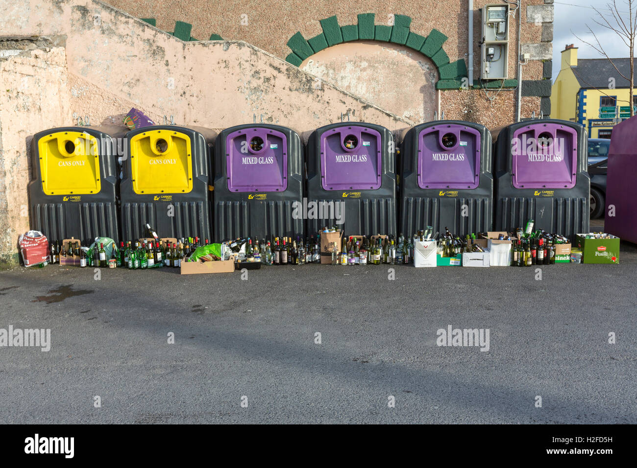Glass bin recycling contained full of bottles Dunfanaghy, County Donegal, Ireland Stock Photo