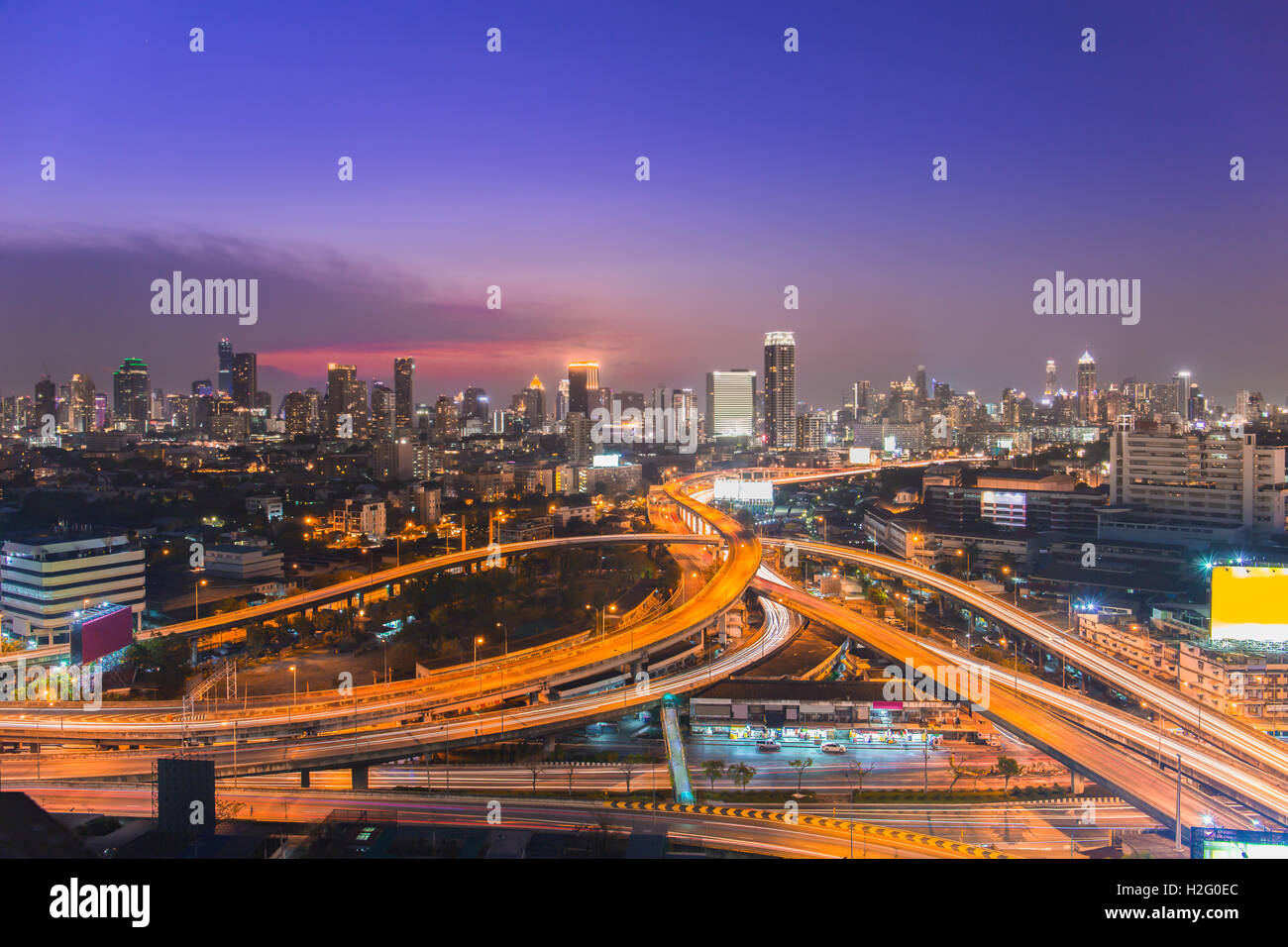 Bangkok skylines and highway traffic motion in the sunset. The View from the top, Thailand. City scape and civilization - Stock Image