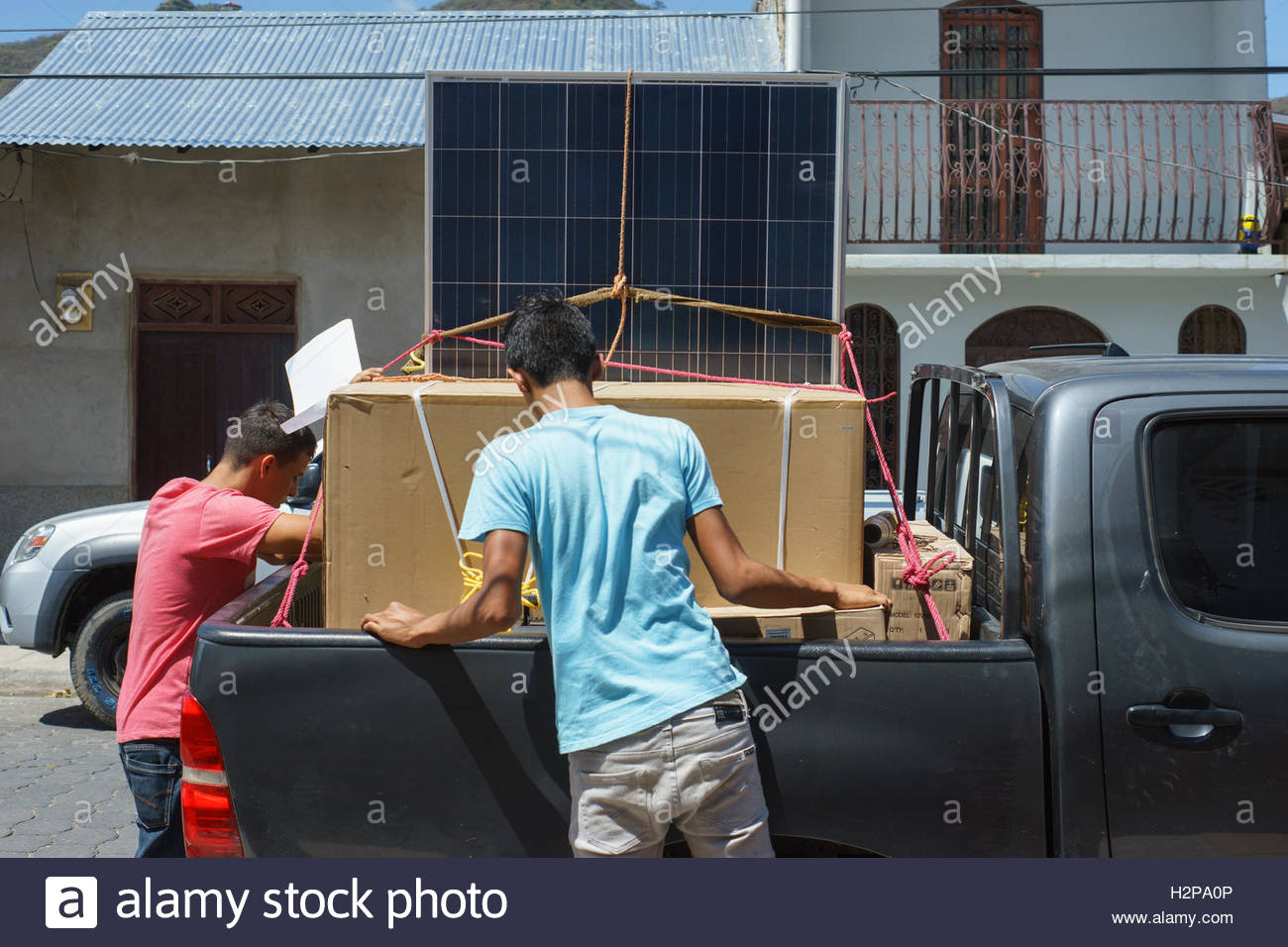 Men loading solar panels in Jinotega, Nicaragua Stock Photo