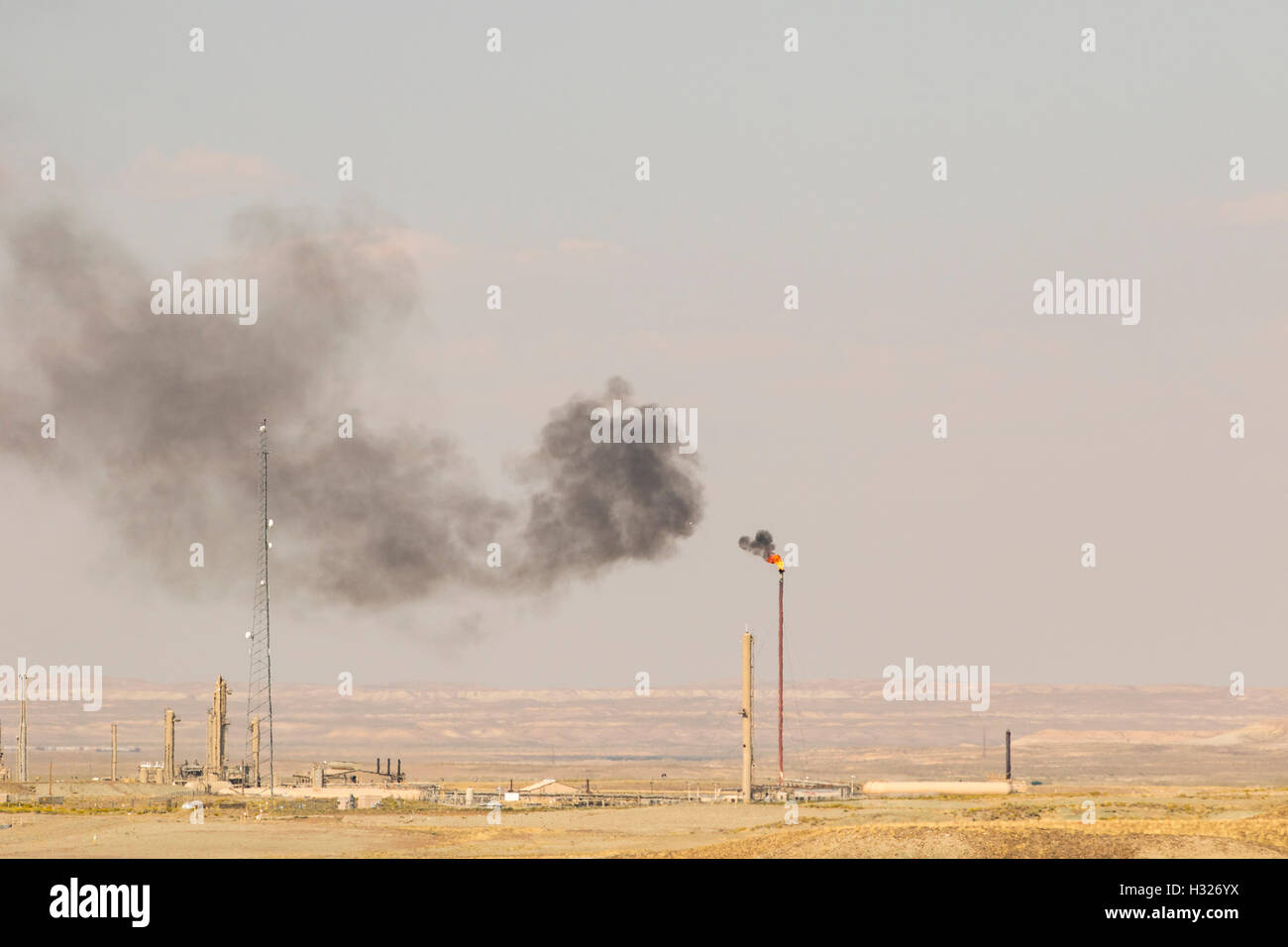 Climate change and global warming caused by air pollution from smoke stack. - Stock Image