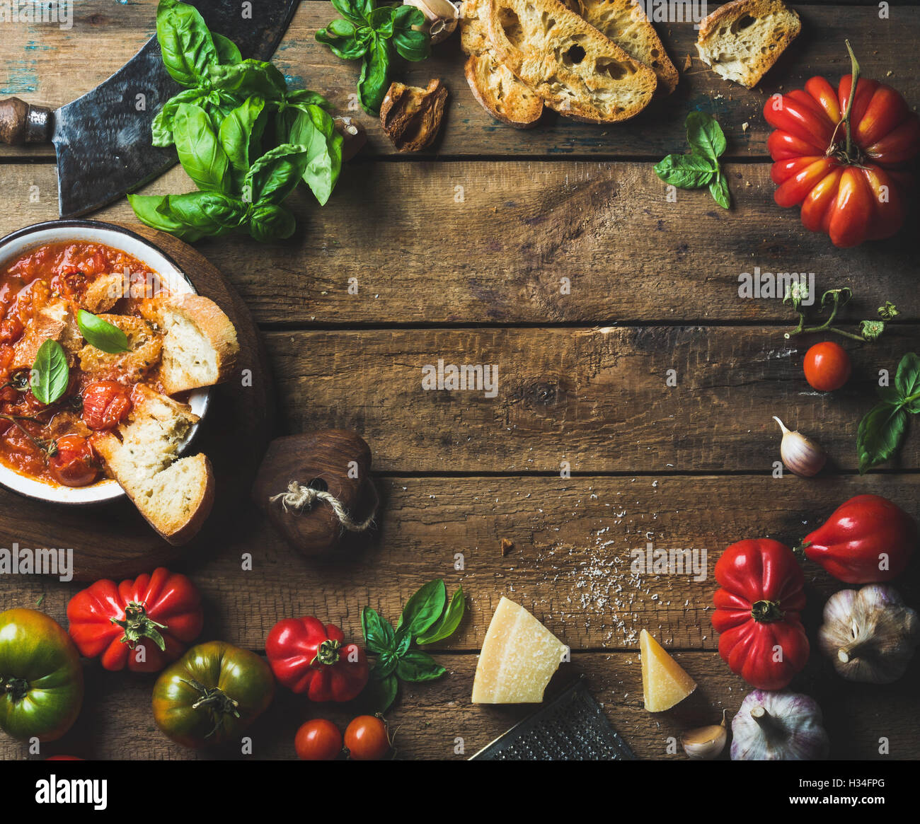 Italian roasted tomato and garlic soup with bread, basil, parmesan - Stock Image