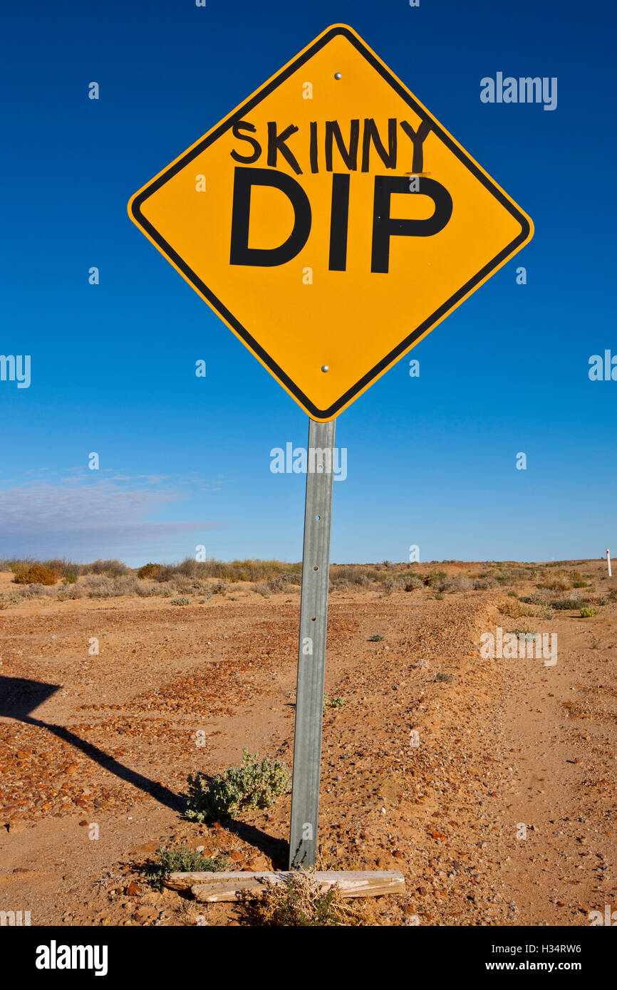 Oodnadatta Track. Australian humour added to 'DIP' road signs along way. - Stock Image