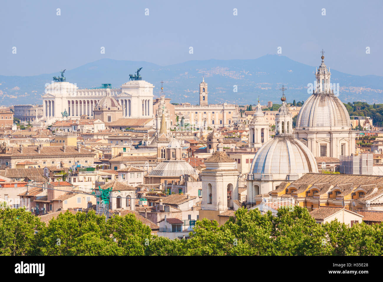 Churches and domes of the Rome skyline showing Victor Emmanuel II monument in the distance, Rome, Lazio, Italy - Stock Image