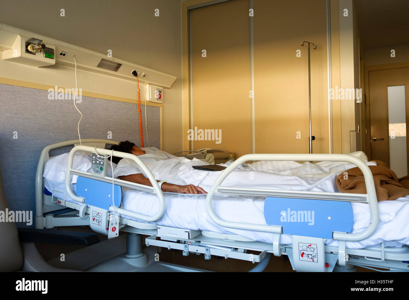 Evening Light In Room, Woman, Lying In Hospital Bed.