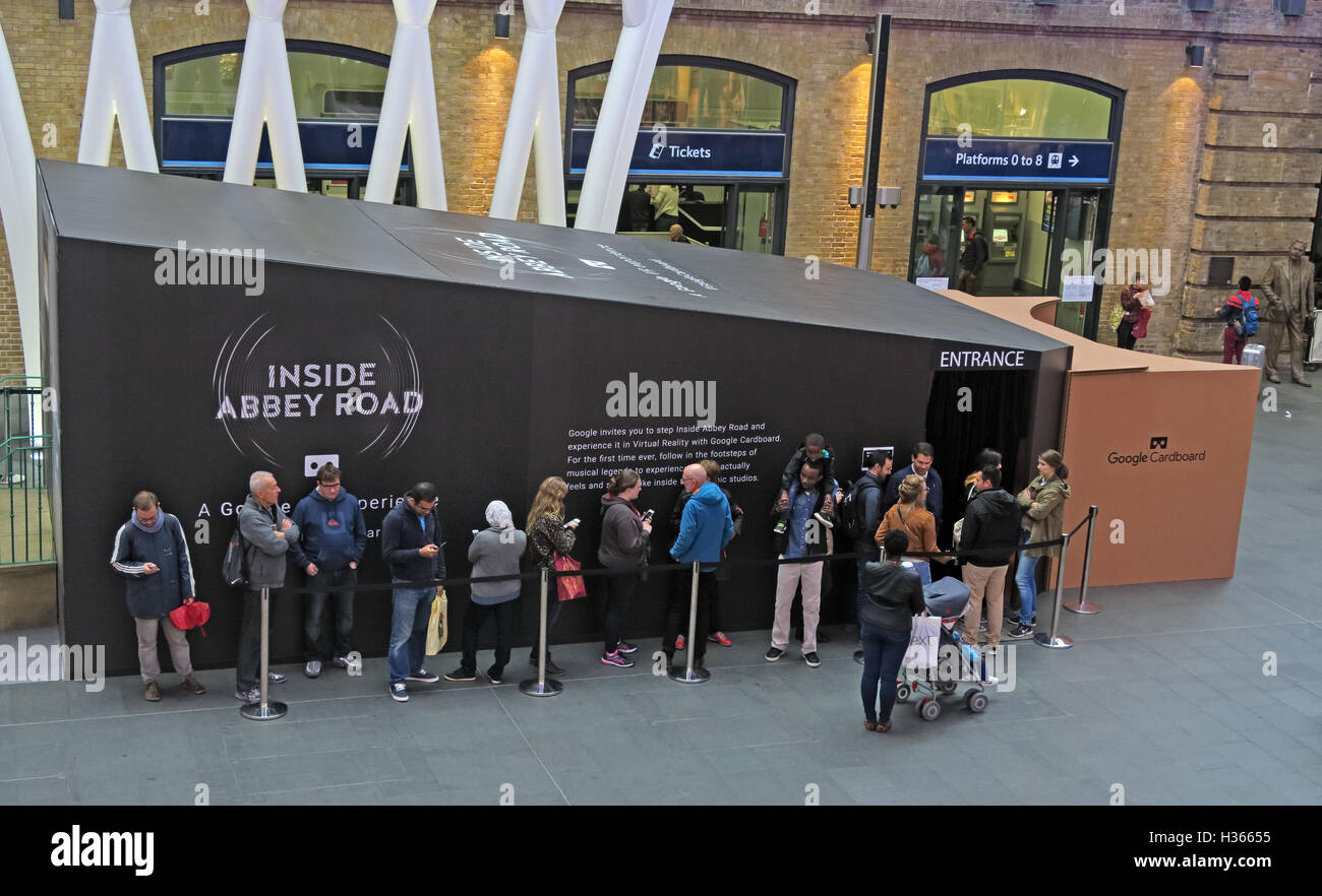 Queue,of,people,VR,Virtual,Reality,AR,promoting,studio,studios,at,Kings,Cross,Rail,Railway,Station,London,entrance,platform,fold,out,viewer,Smartphone,Daydream,Queue of people,Google Cardboard,Virtual Reality,Augmented Reality,Inside Abbey Road,Kings Cross,GoTonySmith,@HotpixUK,Tony,Smith,different,unique,smartphones,NME,iconic,musical,landmark,Buy Pictures of,Buy Images Of,Images of,Stock Images,Tony Smith,Photo of,Fold Out,Google Store