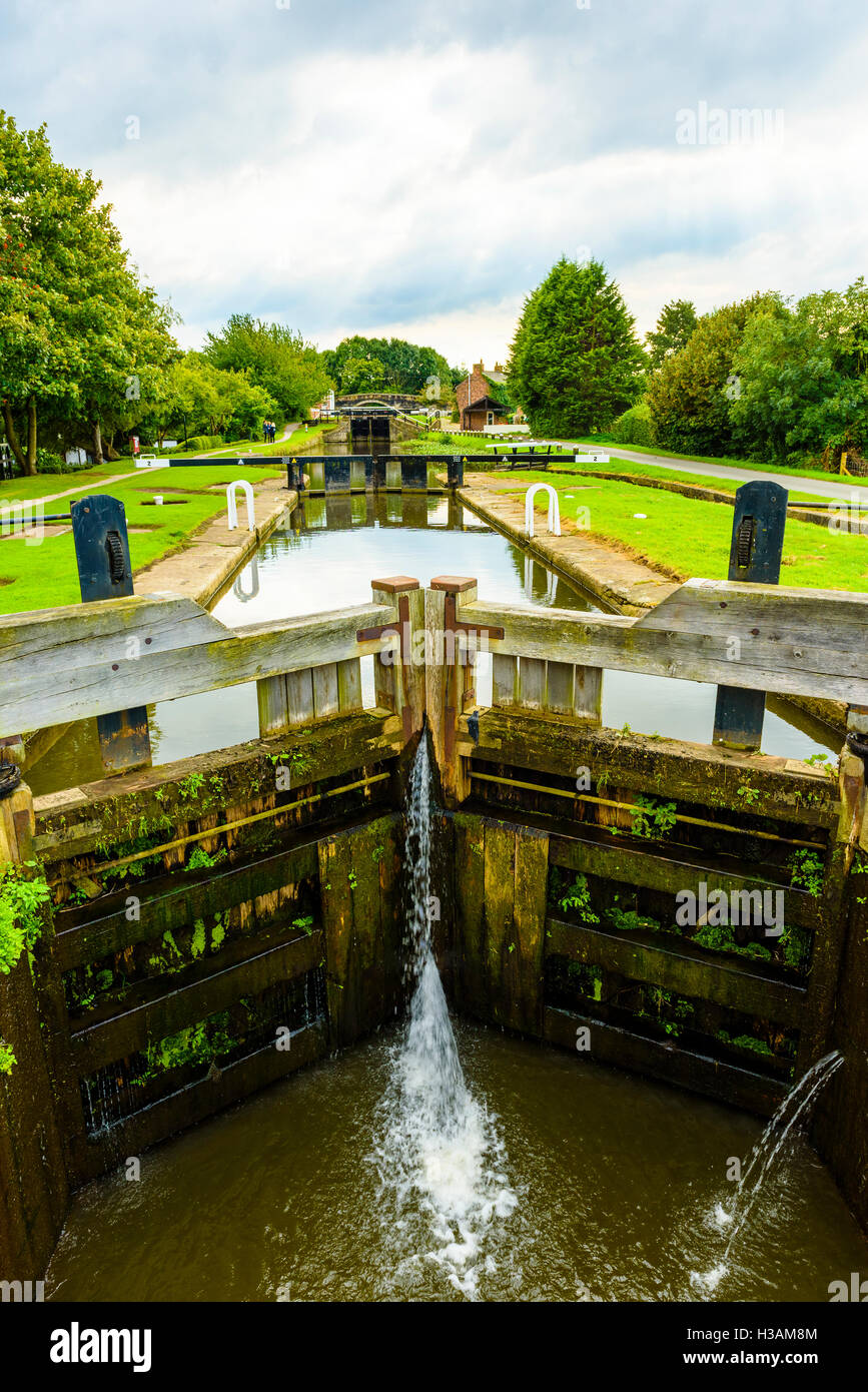Locks on the Rufford Branch of the Leeds and Liverpool Canal just outside Burscough in West Lancashire England UK - Stock Image